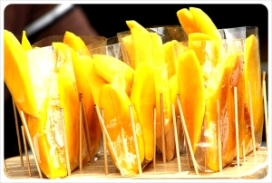 Fresh Cold Mangoes in the heat of Bangkok city.