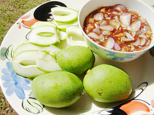 Mangoes with Nam Pla Wan, a thick sweet paste with chili, shallots, and dried shrimps